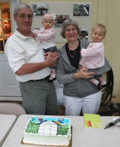 Mike and Bev Perry, founders of Solexx Greenhouses, with their granddaughters